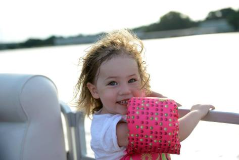 Gorgeous girl, loving the sunset boat ride.