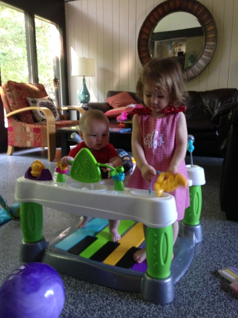 the babes loving the (descriptively named) Fisher-Price Superstar Step 'N Play Piano