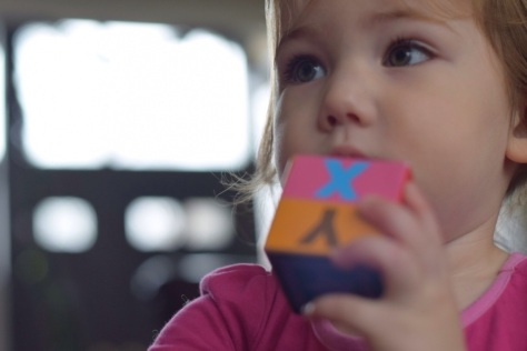 EK with her nesting and stacking (cardboard) alphabet blocks from Melissa and Doug.