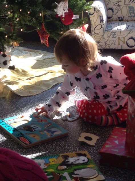 Christmas morning, 2013, EK playing with her instruments puzzle (that makes sounds!)