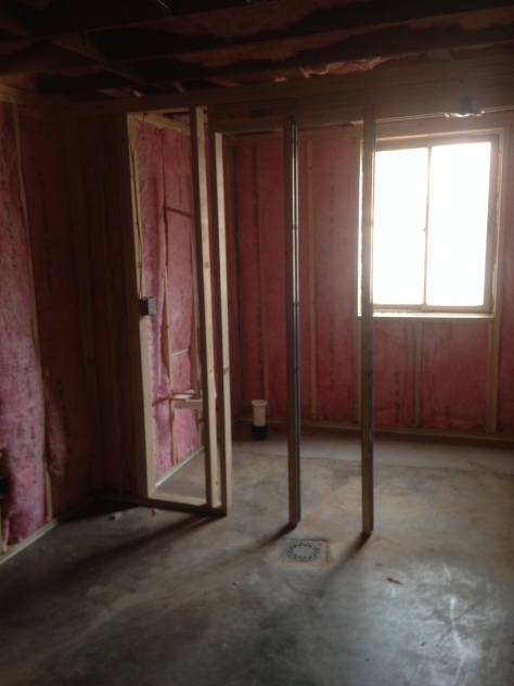 Standing in the mudroom, looking into the powder room.